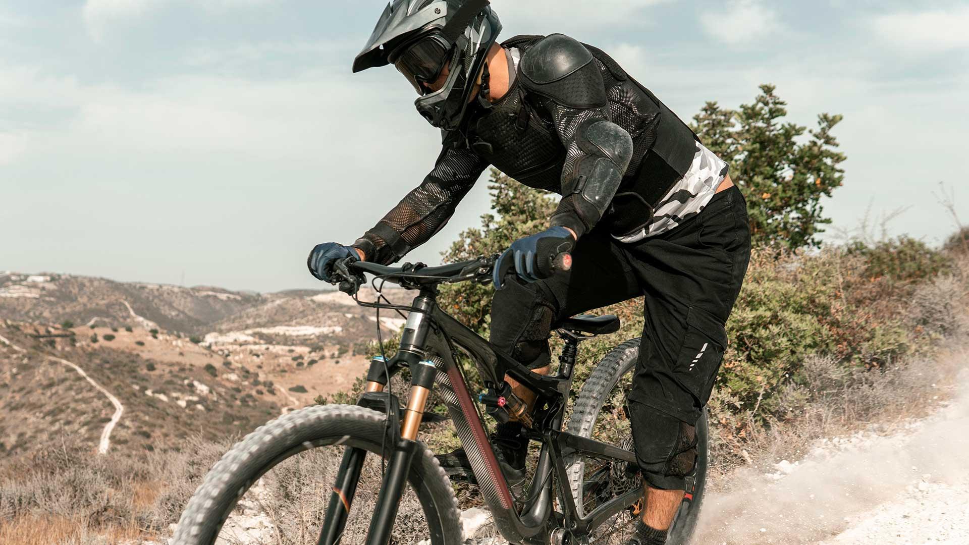man-riding-mountain-bike-outdoors
